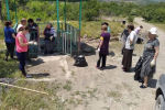 Сотрудники станции юннатов убирают источник близ Цхинвала