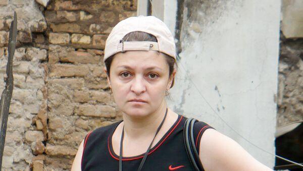 Ревмира Алборова у пепелища своего дома во время войны 08.08.08 - Sputnik Южная Осетия