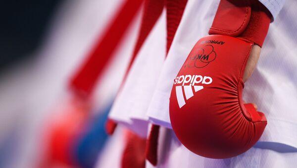 Спортсмен перед началом соревнований по карате. Архивное фото - Sputnik Южная Осетия
